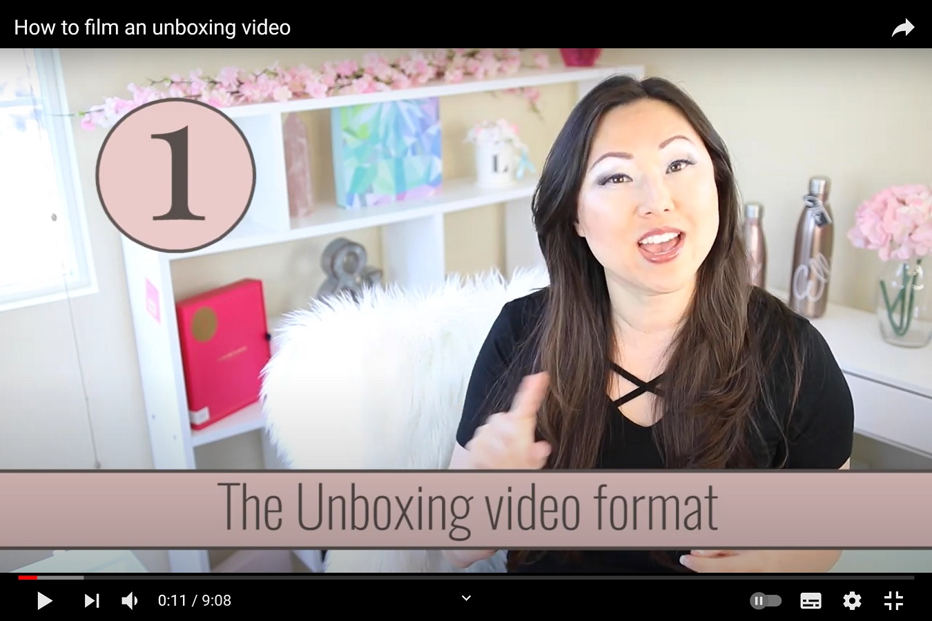 "An image from a video entitled ""How to film an unboxing video"", showing the genrified nature of the video."